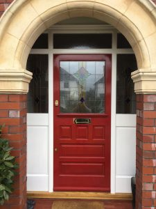 Red stained glass entrance door